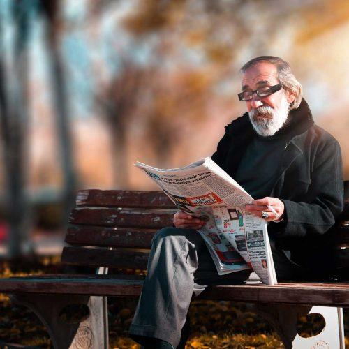 Man Reading Newspaper - idaho falls attorney
