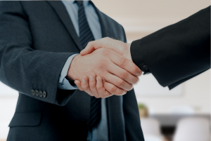 US trademark attorney shaking hands with client